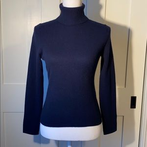 Navy blue, 100% cashmere turtleneck sweater.